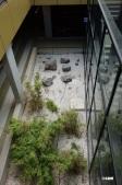 Not just a garage. It is also a zen garden.